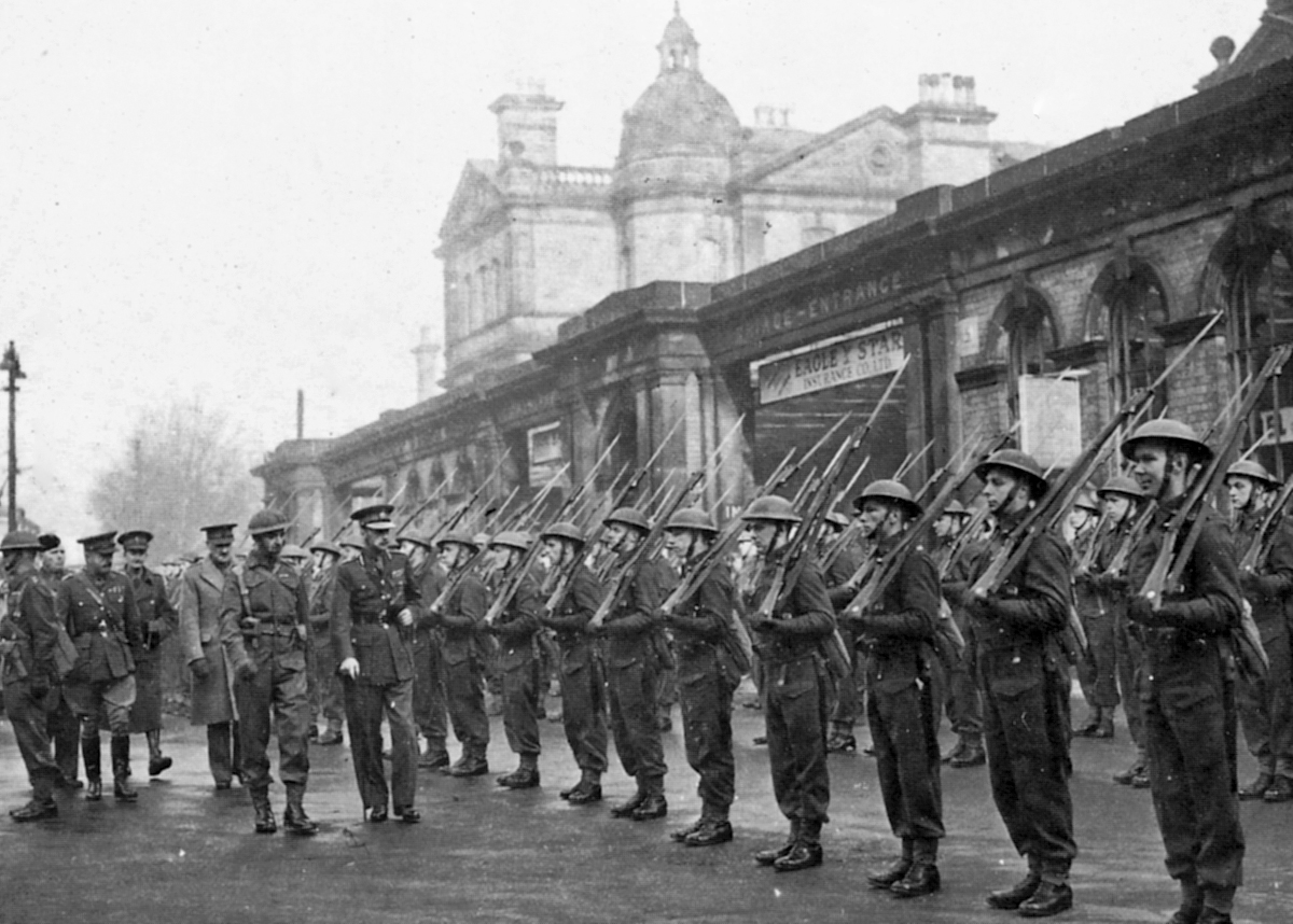 Troops outside Derby Midland railway station, being inspected by the Duke of Devonshire in 1941.