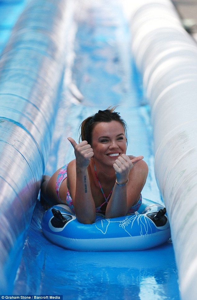 Hundreds of thrill-seekers took their chance to slide down a giant water slide. The 100m (328ft) inflatable slide went up in Kipling Drive in Mickleover for the day. Part-sponsored by Huub, Maria Fowler is one of the first to give it a go,